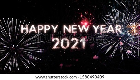 Real fireworks on deep black sky background, with New Year message 2021 with typography design #1580490409