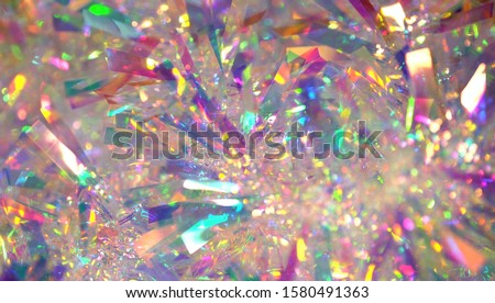 Holographic iridescent tinsel. Hologram Background of abstract shiny foil texture with rainbow colors. Neon pastel gradient of real surface #1580491363