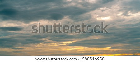 Morning sunrise sky and white clouds. Beautiful golden sunrise sky with white fluffy clouds. White fluffy cloudscape abstract background. Beauty in nature. Dramatic heaven sky. Art picture background