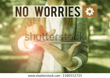 Text sign showing No Worries. Conceptual photo an expression used to say that everything is all right Outdoor scene with business woman holds lap top with touch screen. #1580552725