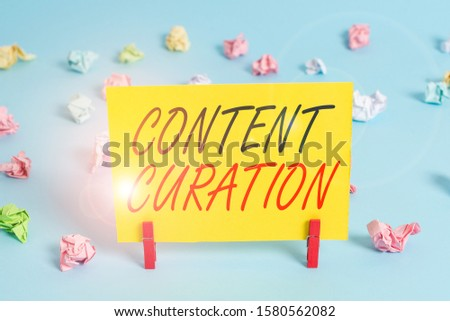 Text sign showing Content Curation. Conceptual photo process of gathering information related to a certain topic Colored crumpled rectangle shaped reminder paper light blue background.
