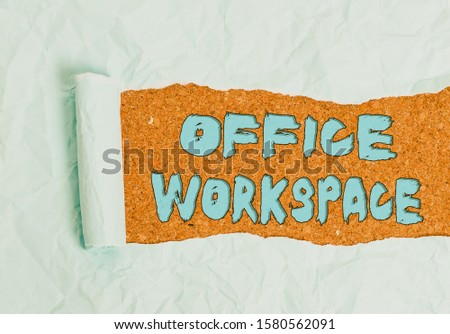 Word writing text Office Workspace. Business concept for any location or venue where demonstrating work is performed Cardboard which is torn in the middle placed above a wooden classic table. #1580562091