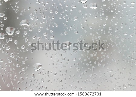 Rain drops on the window, background with drops on the glass #1580672701
