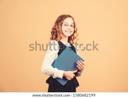 Final exam coming. Girl hold textbook folder test. Preparing to exams in library. Small child formal wear. Formal education and homeschooling. Check knowledge. School exam concept. Prepare for exam. #1580682199