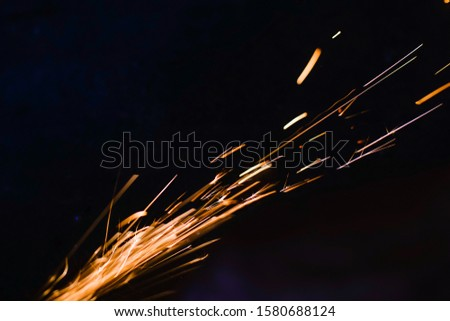 worker cuts a metal pipe by means of the abrasive tool #1580688124