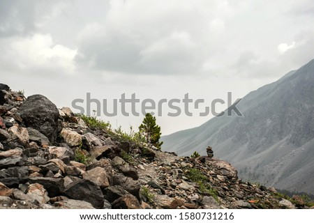 Crossing mountains is like a mail envelope. Trail in the mountains. A sign of where to go in the mountains is a cairn. #1580731216