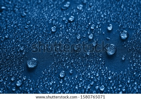 water drops on the fabric surface macro photo #1580765071