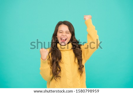 Adorable smiling girl wear yellow sweater turquoise background. Positivity concept. Good vibes. Emotional baby. Positive child. Positive attitude to life. Inspiration. Positive mood. Kids psychology. #1580798959