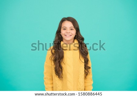 Positivity concept. Good vibes. Emotional baby. Positive child. Positive attitude to life. Inspiration. Positive mood. Kids psychology. Adorable smiling girl wear yellow sweater turquoise background. #1580886445
