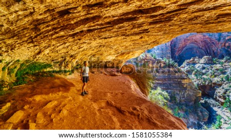 Active Senior woman in a cave on a hike on the Canyon Overlook Trail in Zion National Park, Utah, United States #1581055384