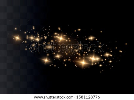Light effect of dust. Golden stars shine with a special light. The light sparkles on a transparent background. Christmas bright dust effect. #1581128776