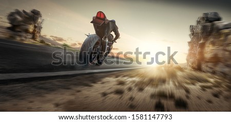 Motorcycle is driving in the sunset #1581147793