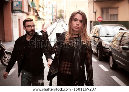 young woman and young man street story punks #1581169237