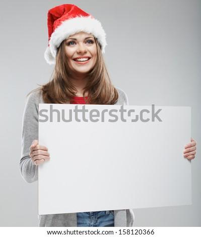 Woman christmas portrait hold white banner. Santa Christmas hat. Isolated portrait. #158120366