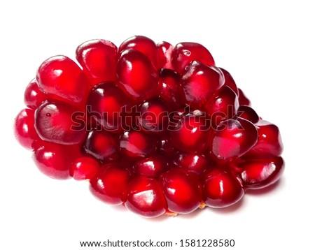 Pomegranate garnet seeds fruit cut. Pomegranate seeds isolated on white. Fresh raw organic garnet fruit cut seeds on white background. Pile set ruby pomegranate (garnet fruit) isolate. Grenade fruit #1581228580