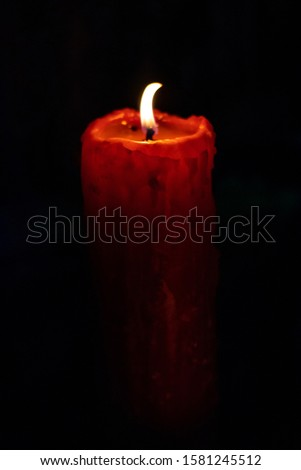 photo of red candles with black background #1581245512