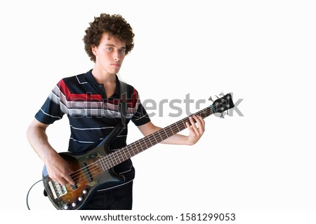 Cut out of young man playing bass guitar at camera #1581299053