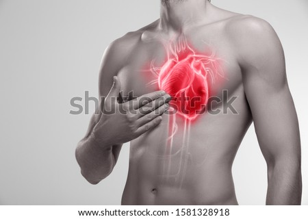 Human heart, man holding his hand in the area of chest #1581328918