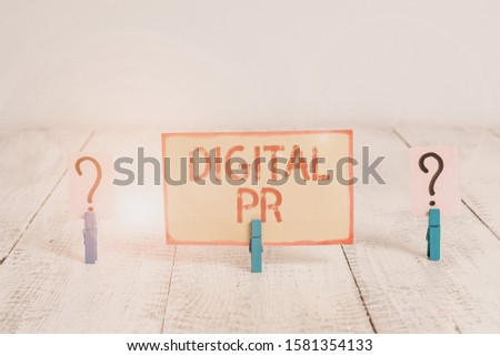 Text sign showing Digital Pr. Conceptual photo marketing strategy used to increase their online presence Scribbled and crumbling sheet with paper clips placed on the wooden table.