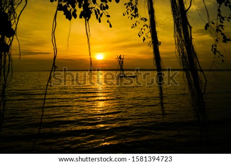Dusk And Fishermen who are in the ocean #1581394723