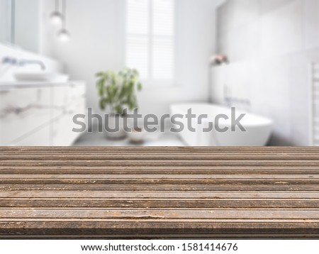 Empty tabletop for product display with blurred bathroom interior background  #1581414676