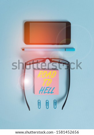 Word writing text Road To Hell. Business concept for Extremely dangerous passageway Dark Ri Unsafe travel Dark eyeglasses colored sticky note smartphone pen clips pastel background. #1581452656