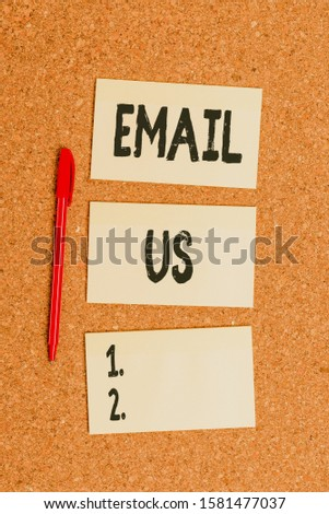 Conceptual hand writing showing Email Us. Business photo showcasing Sending a commercial message to a group of showing using mail Empty sticker reminder memo billboard corkboard desk paper. #1581477037