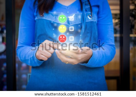 woman select happy face emoticon on virtual touch screen at smartphone #1581512461