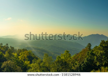 Beautiful view on the top of the mountain sunshining and clear sky  #1581528946
