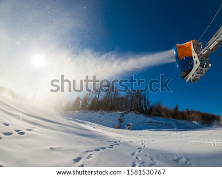 Production of snow with snow making machine at Jaworzyna Mountain. Krynica Resort, Poland. #1581530767