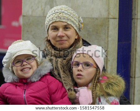 Ukrainian woman on a winter walk with her two daughters #1581547558
