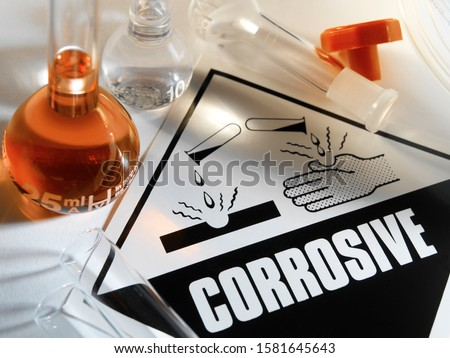 Corrosive Warning Sign - A corrosive substance is one that will damage or destroy other substances with which it comes into contact by means of a chemical reaction. #1581645643