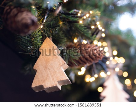 Christmas wooden pine tree with fir tree and fir cones in the background #1581689551