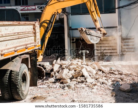Bulldozer Removes the debris from demolition on the construction site Royalty-Free Stock Photo #1581735586
