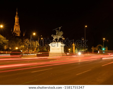 Night view of Equestrian statue of El Cid in Seville, Spain. #1581755347