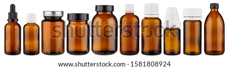 Set collection row of various brown medicine pill glass pipette dropper bottle blank without copyspace label design pattern isolated on white panorama background Royalty-Free Stock Photo #1581808924