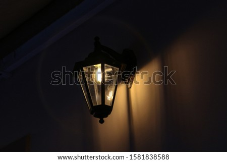 Old street lamps illuminate the way for passersby #1581838588