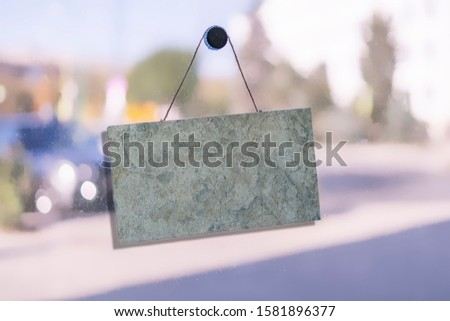 simple sign board frame hanging on the wall of the building exterior with copy space mock up, design for text