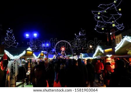 Crowd walk in Christmas Market in Brussels, Belgium on Dec. 1, 2019 #1581903064