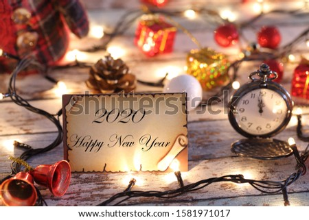 Greeting card for new year or christmas with Christmas lights, snowman, pocket watch, and decorations #1581971017