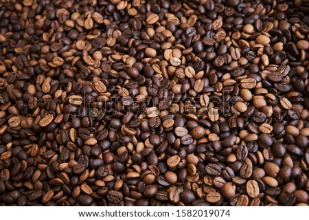 A lot of roasted dark brown and light brown coffee beans as background. #1582019074