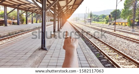 Many railways are connected.The tourist hand points to the train station that is the target of the trip.Railway stations of old in ASEAN.The rails are made of steel, wood, gravel and brick block. #1582117063