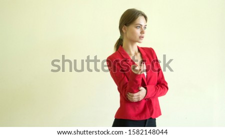 Let me think. Doubtful thoughtful woman with thoughtful facial expression, presses her lips, holds her hand under her chin, plans something or makes a choice, poses on a gray background  #1582148044