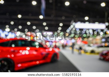 Abstract blur for background : The exhibition shows the innovation of cars and motorcycles at motor show or motor expo with colorful bokeh #1582193116