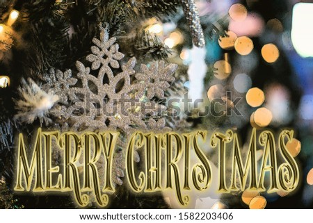 sparkling gold and silver lights Merry Christmas and Happy New Year greeting message on background,snow flakes,bright lights decoration.Elegant holiday season social post digital card #1582203406
