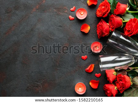 Valentines day romantic background - red roses, glasses, candle and hearts. Flat lay, copy space.  #1582210165