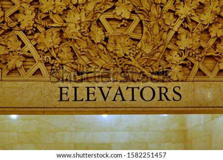 Inscription engraved on a wall: Elevators.