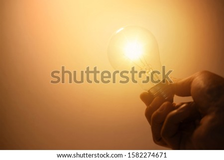 Businessmen holding light bulbs, ideas of new ideas with innovative technology and creativity. #1582274671