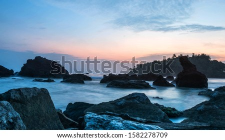 Best Place to visit in Kerala Darmadam Beach, Colorful Beach Sky with rock #1582278709