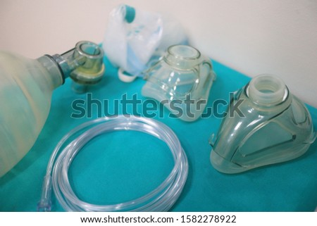 Medical equipment for airway management : mask, mask with bag and Reservoir bag on green                                                  Royalty-Free Stock Photo #1582278922